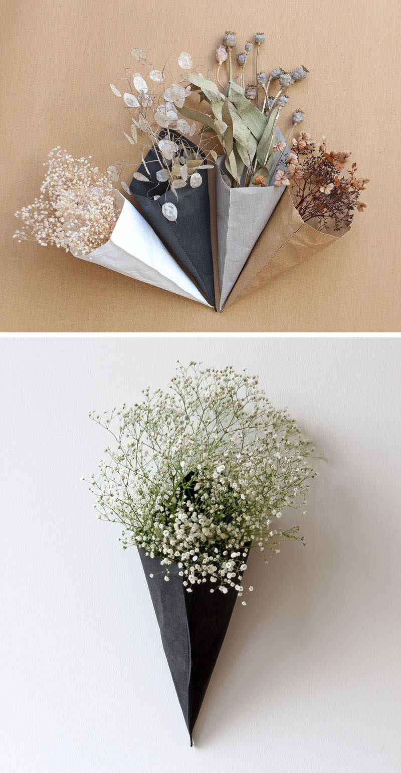 Wall Decor Idea - These modern cone-shaped wall planters and storage pieces are made from a material that looks like paper. #ModernDecor #WallDecorIdeas #ModernWallPlanters #StorageIdeas #WallStorage