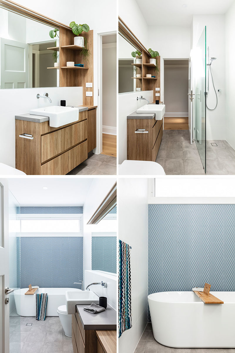 Bathroom Ideas - This bathroom combines a wood vanity and a blue-grey tile accent wall for modern appearance. #ModernBathroom #WoodVanity #AccentWall #BathroomIdeas