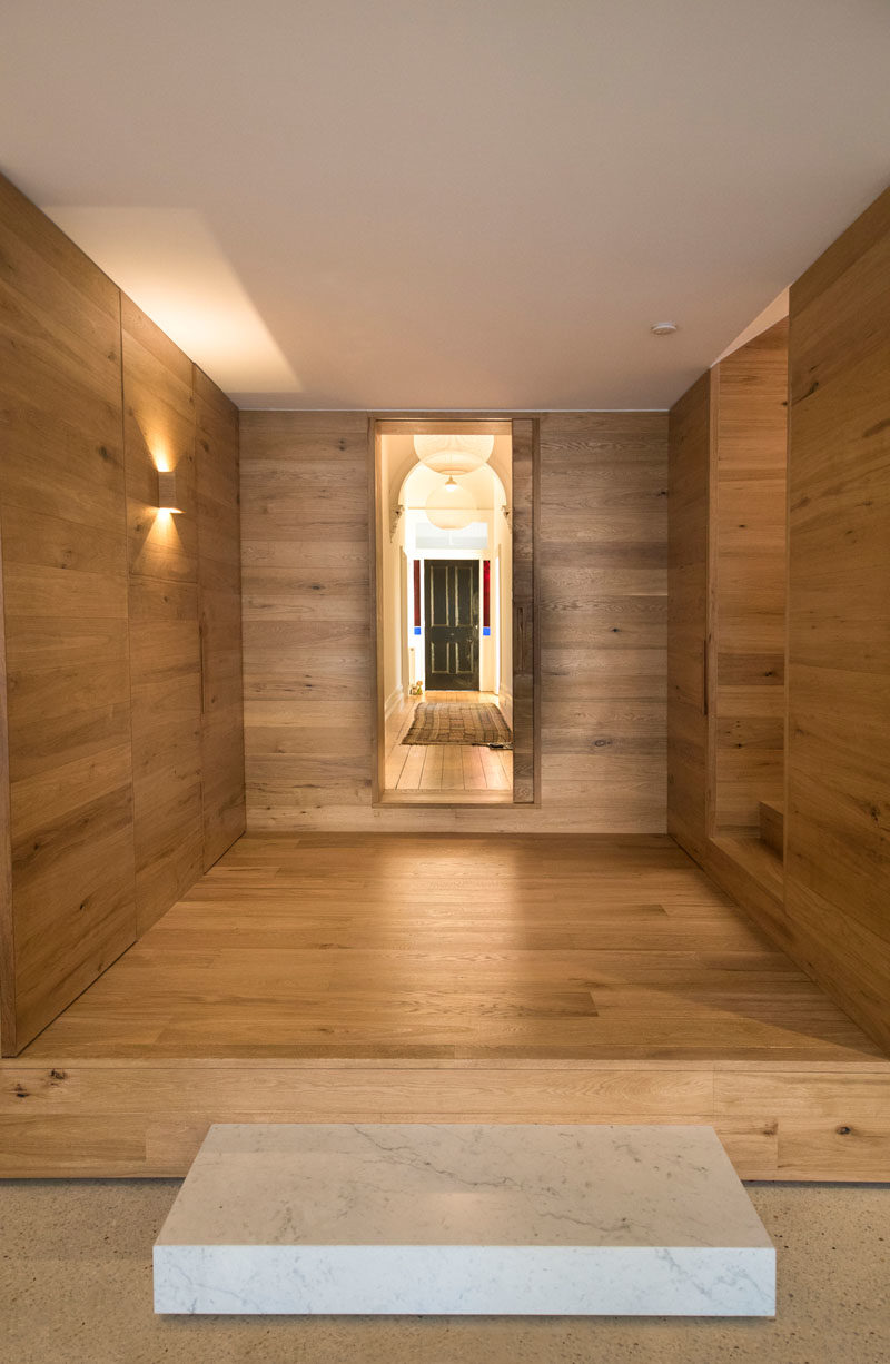This wood lined foyer separates the old part of the house from the new modern addition. #Foyer #Stairs