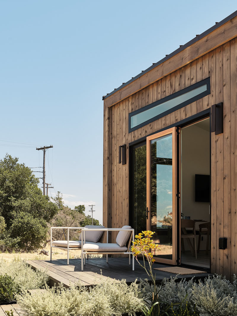 Tiny House Ideas - Drawing influence from the Californian coast, this modern tiny house showcases naturally-stained cedar siding and a standing-seam metal roof. #ModernTinyHouse #TinyHouseIdeas #TinyHouseArchitecture #TinyHouseDesign #TinyHouse