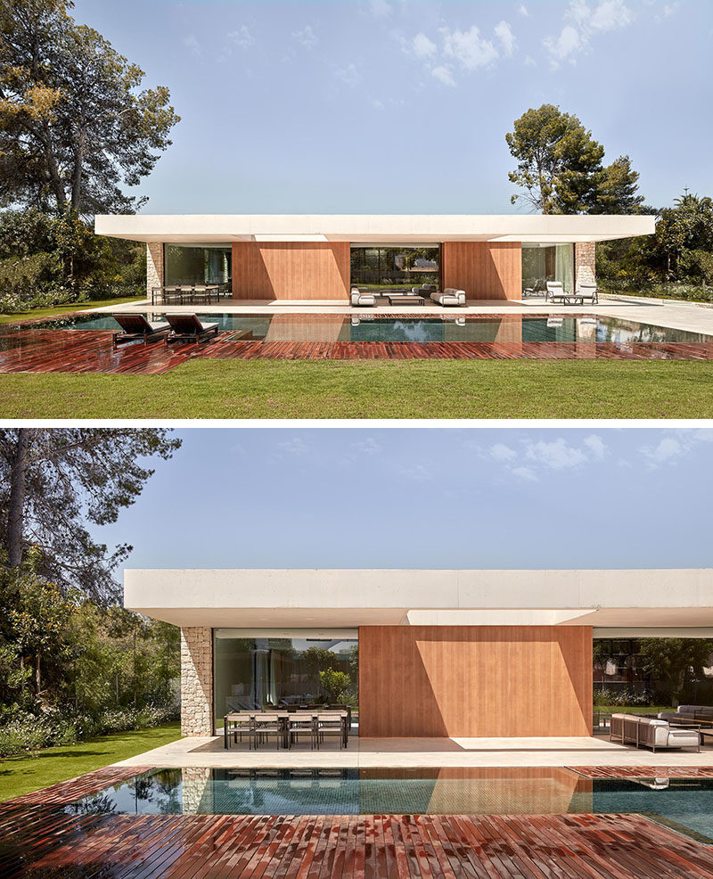 Outdoor Space - This modern house has an outdoor space that sits below a large cantilever of white concrete that has two perforations to allow the entrance of sunlight. #OutdoorSpace #Architecture #SwimmingPool #ModernHouse