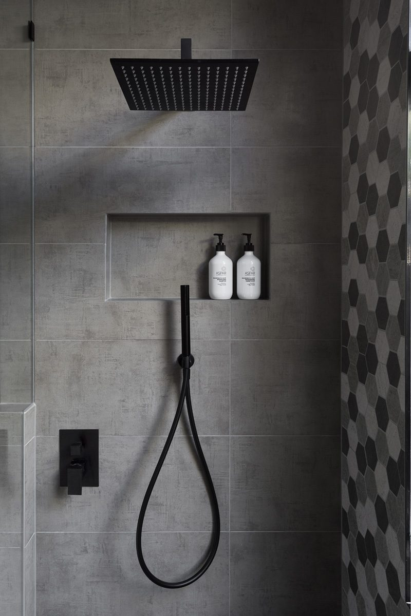A great way to add storage and style to a bathroom is by creating a shower niche. A shower niche replaces the need for a corner shelf or a hanging caddy, and adds a luxurious touch to the bathroom. #ShowerNicheIdeas #ShowerNiche #ModernBathroom #BathroomStorage #ShowerShelf #ShowerNook