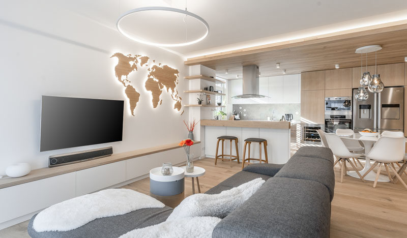 Indirect lighting highlights a variety of design aspects throughout the this modern apartment. #LightingIdeas #ModernLighting #HiddenLighting #LivingRoomIdeas