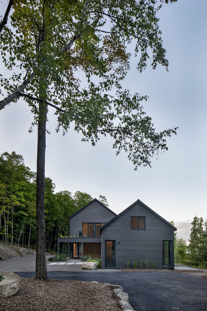 Modern Barnhouse Ideas - This modern barnhouse is designed as two separate areas, the first, a combined guest loft, garage and artist studio, that's connected by a glass tunnel to the second, the main house. #ModernBarnhouse #ModernArchitecture #BarnhouseDesign
