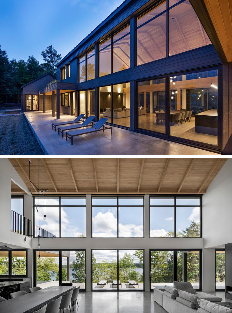 Window Ideas - This modern barnhouse has a large open-plan great room that's lined with a wall of windows. #ModernBarnhouse #Windows #ModernArchitecture