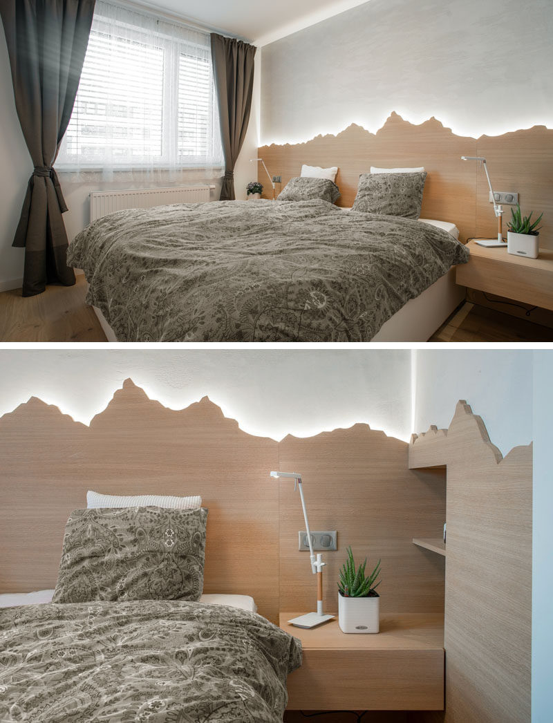 Headboard Ideas - In this modern bedroom, there's a custom backlit wood headboard that showcases the outline of mountains. #HeadboardIdeas #ModernBedroom #BacklitHeadboard #BedroomIdeas