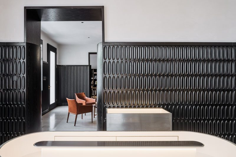 A dramatic design accent was created in this modern house, by adding black wainscoting that covers two thirds of the walls. #ModernInterior #BlackWainscoting #InteriorDesign #Interiors #BlackTiles