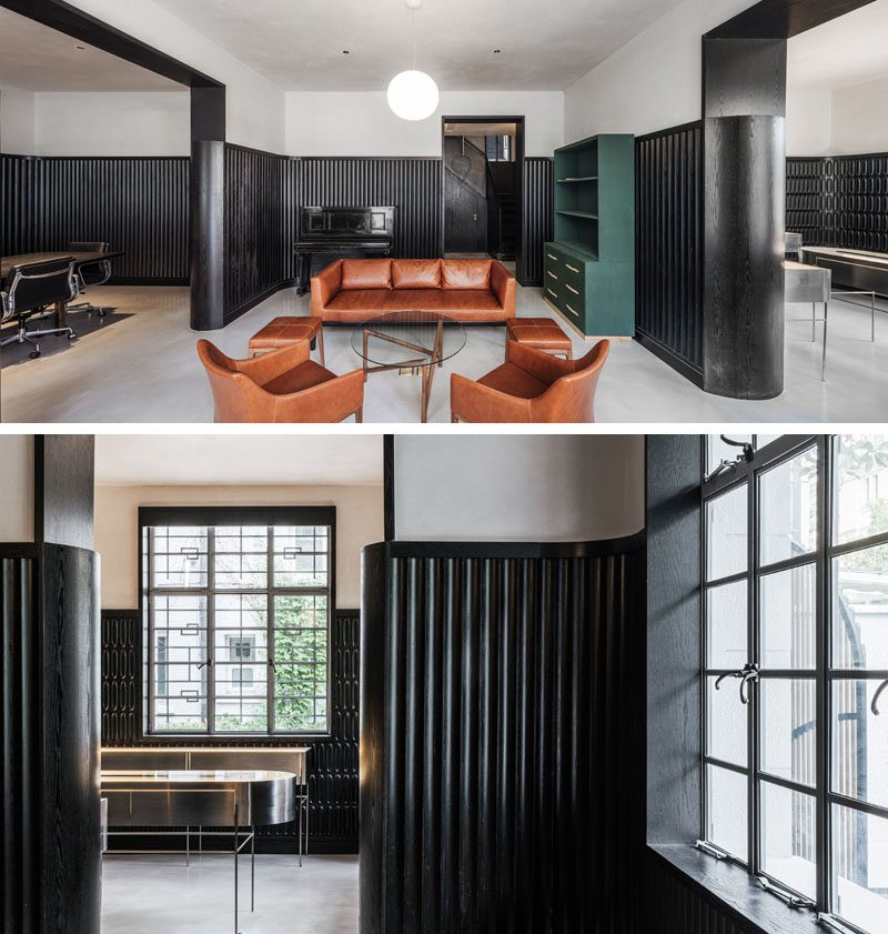 A dramatic design accent was created in this modern house, by adding black wainscoting that covers two thirds of the walls. #ModernInterior #BlackWainscoting #InteriorDesign #Interiors #BlackTexturedWalls