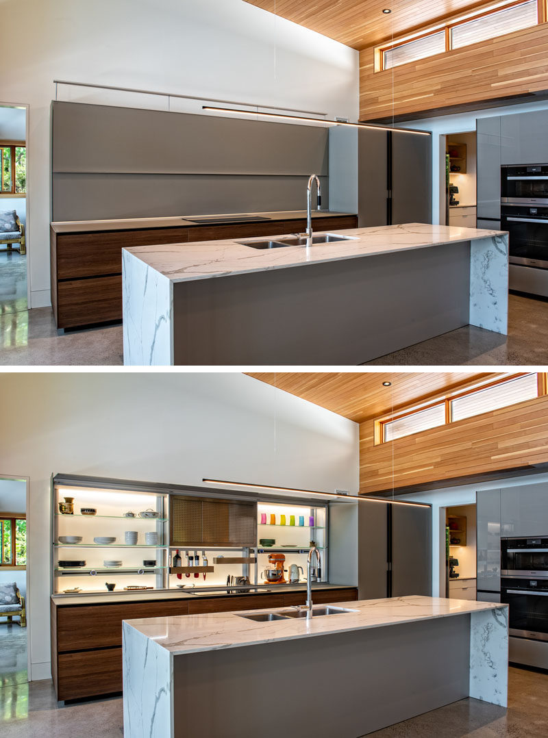 Kitchen Ideas - In the kitchen of this modern cottage, the backlit cabinets by Valcuccine, connects with a walk-in pantry and outdoor barbecue area, creating an optimal chefs kitchen. #ModernKitchen #BacklitCabinets #KitchenDesign