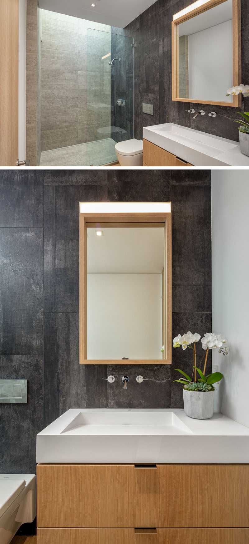 Bathroom Ideas - In this modern bathroom, a skylight adds natural light to the shower, and a wood vanity with matching mirror adds a natural touch. #BathroomIdeas #ModernBathroom #WoodVanity