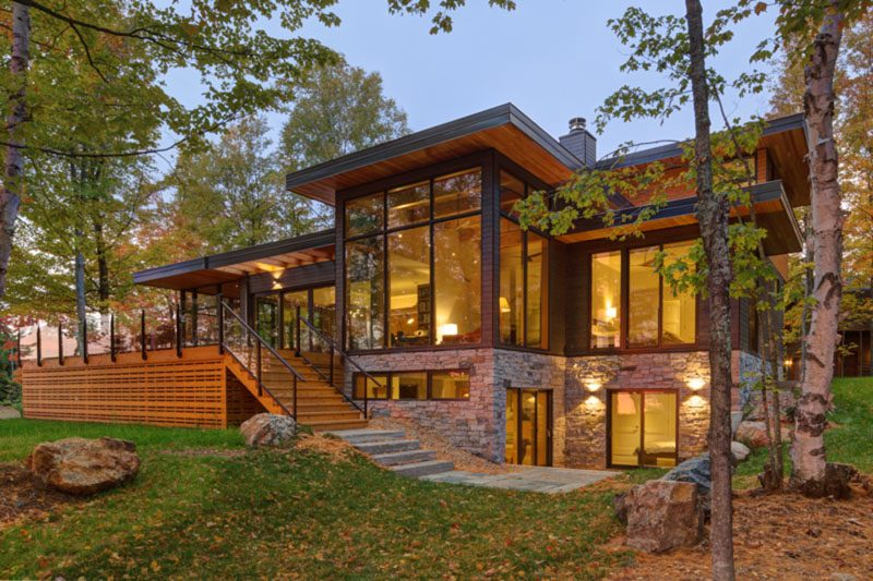 An Old Lakeside Cottage Was Replaced With A New House Made Of Wood, Stone, And Glass