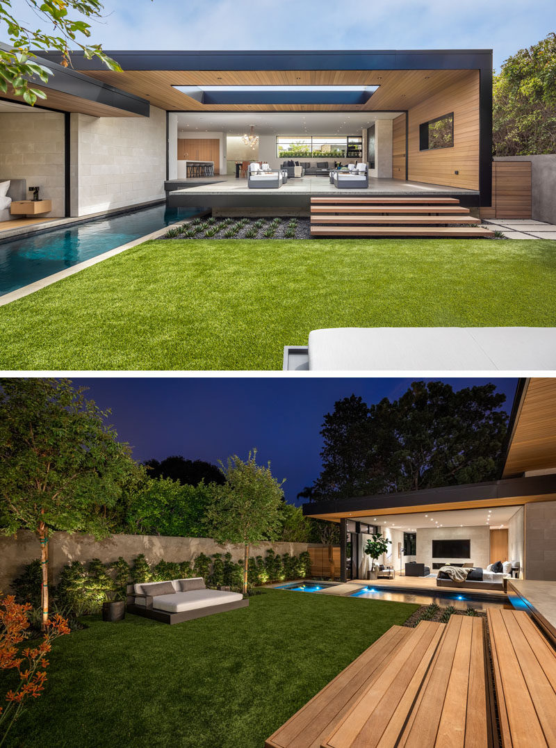 The partially covered patio of this modern house steps down to the yard, where there's a daybed, and a pool with a spa. #OutdoorSpace #Architecture #Landscaping #SwimmingPool