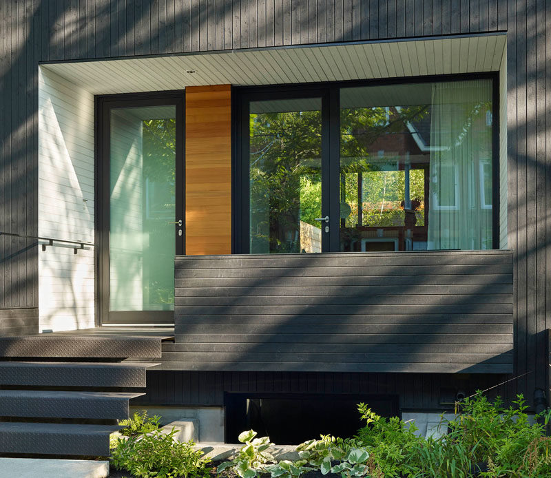 Door Ideas - At the front of this modern house, there's a second entrance that sits next to the front door. As the home owners are avid cyclists, the entrance provides direct access to a lower level with bike storage. #DoorIdeas #FrontDoors #Architecture