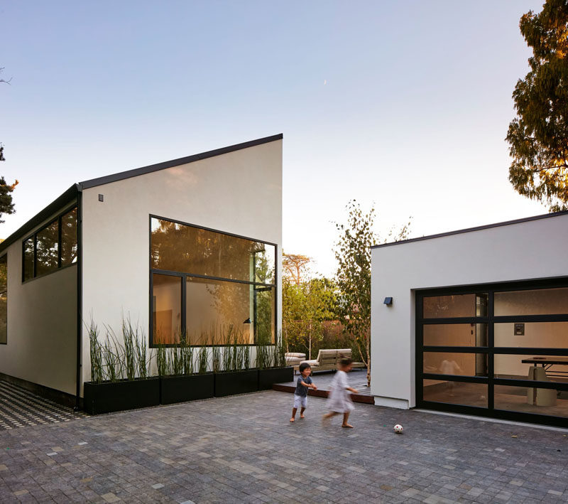 The courtyard of this modern house leads to the detached two car garage is insulated and can be used as a play room or office, if needed. #Architecture #Garage #ModernHouse