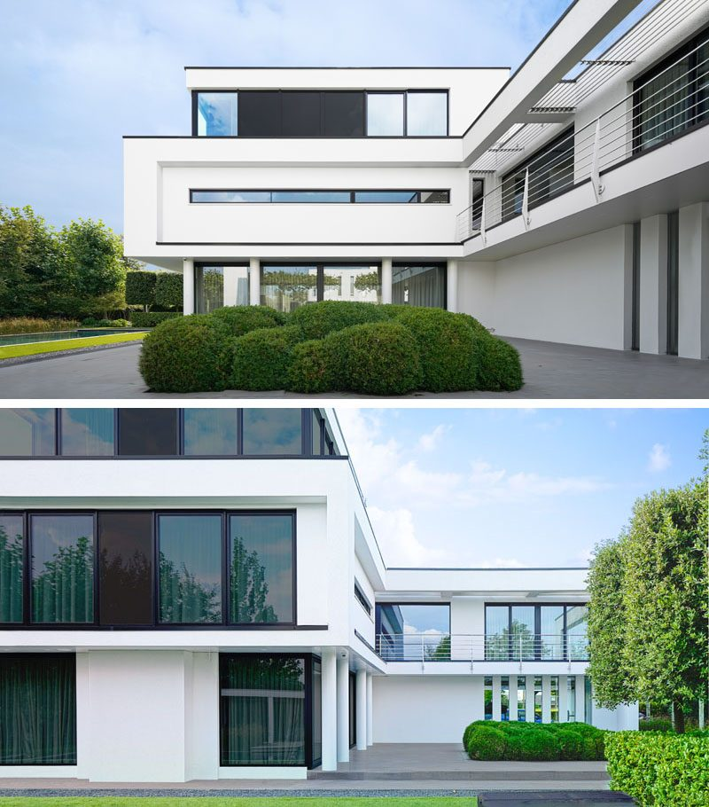 Large and uniquely shaped windows are used in the design of this modern house, to give either privacy or an uninterrupted view of the surrounding greenery. #Windows #ModernHouse #ModernArchitecture