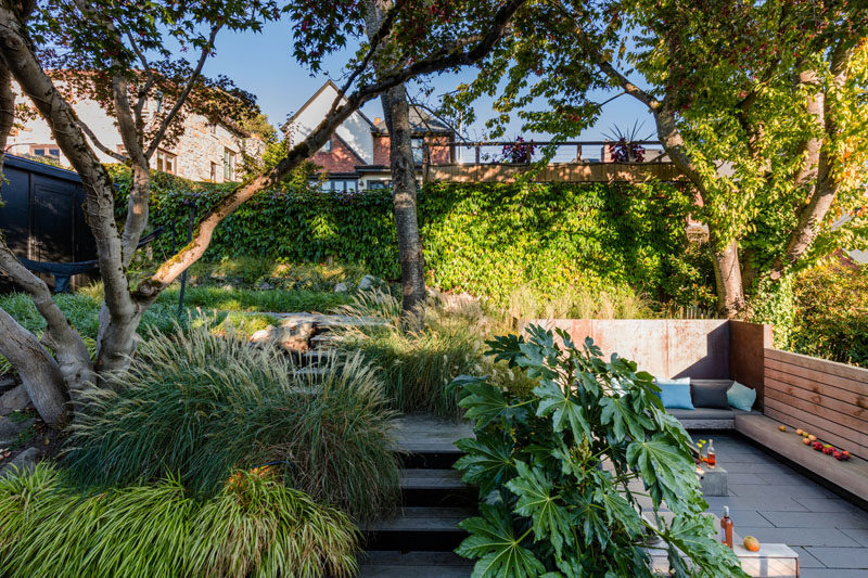 A sunken courtyard is adjacent to a raised garden with steps.