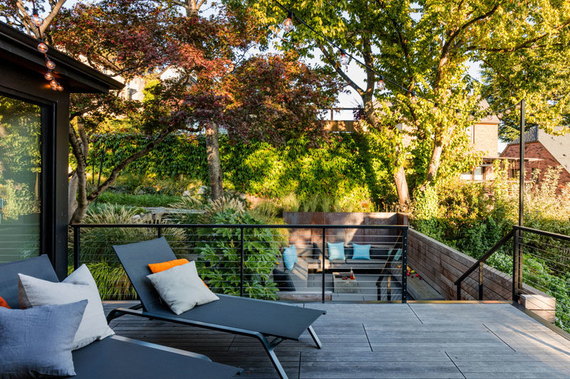 A Ipe hardwood deck with a pair of lounge chairs.