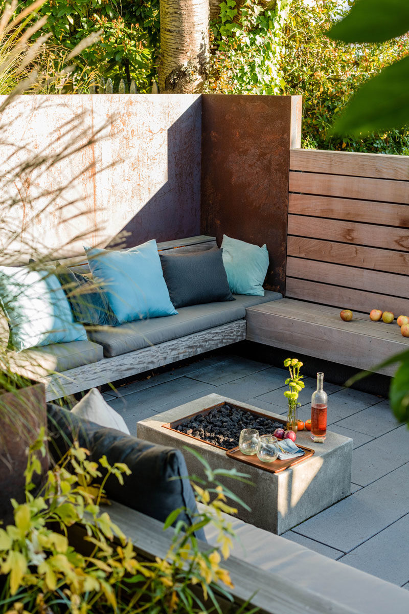 Landscaping Ideas - This sunken courtyard features custom hardwood screens, plate steel retaining walls, ipe wood benches, and handmade cushions by La Fabrique. #LandscapingIdeas #GardenIdeas #OutdoorSpace #Courtyard #OutdoorSeating #GardenIdeas
