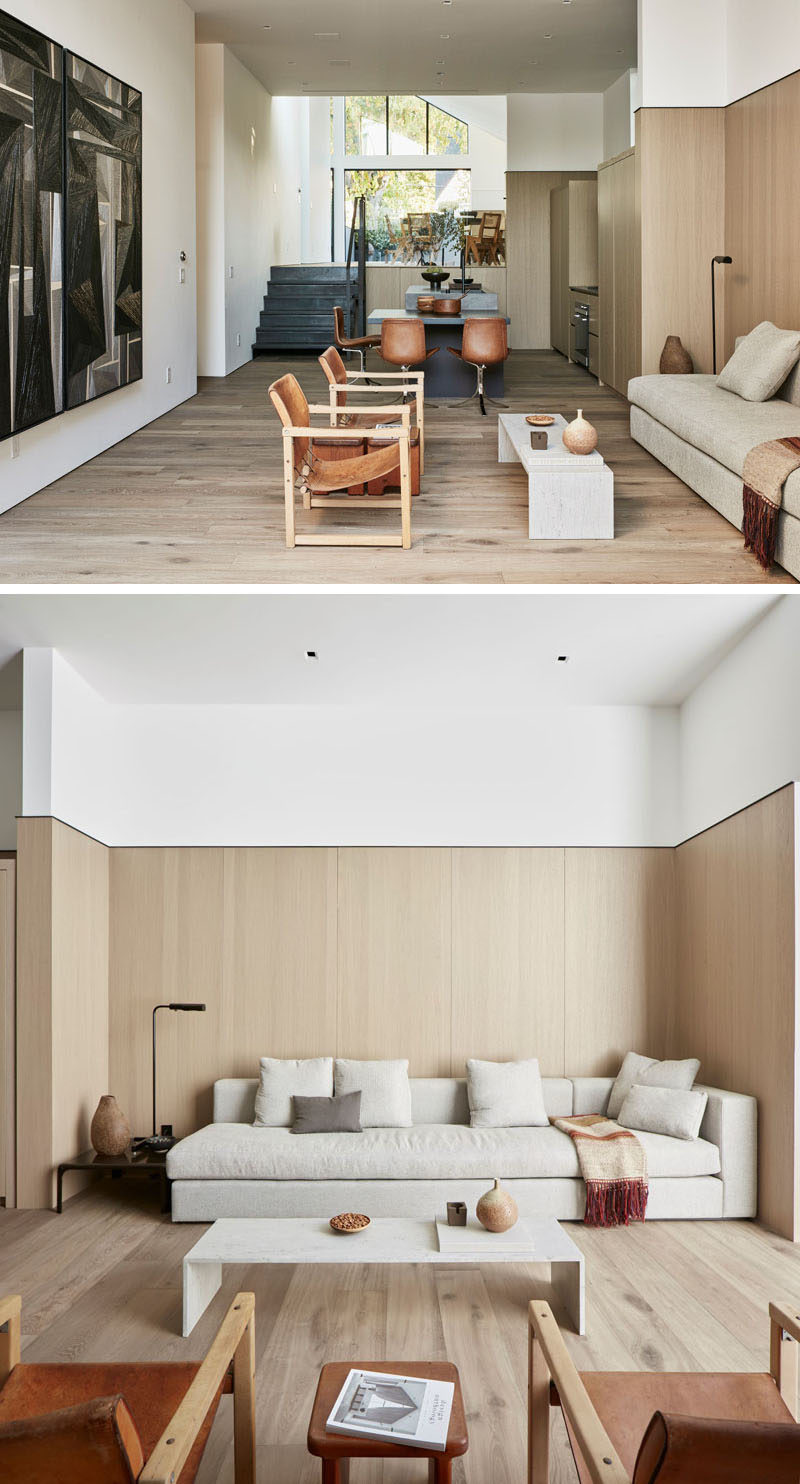 This modern house has a living area that opens to a courtyard at the back of the house. White oak floors have been used throughout the home. #ModernInterior #LivingRoom #Courtyard