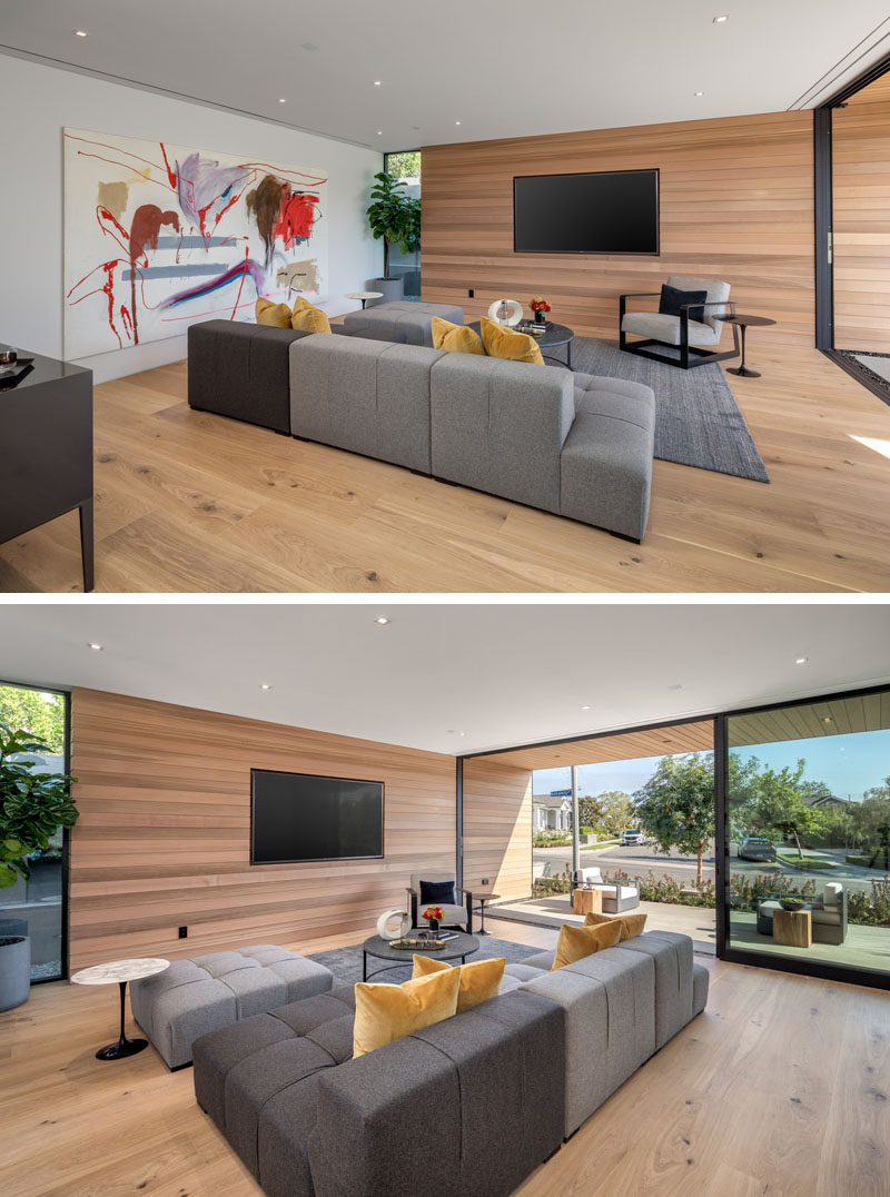 Living Room Ideas - This modern living room has a television recessed into the wood wall, that also continues to the exterior of the house. #ModernLivingRoom #LivingRoomIdeas #WoodAccentWall #RecessedTV