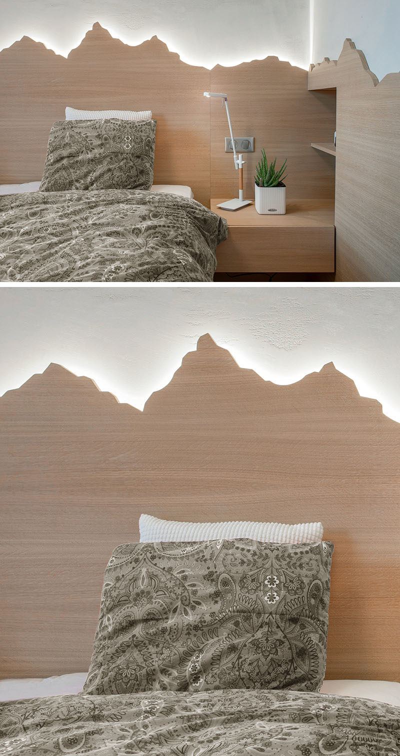 headboard Ideas - Using a mountain range as inspiration, this custom wood headboard with hidden lighting showcases the outline of the mountains and creates a soft glow for the bedroom. #HeadboardIdeas #ModernHeadboard #BedroomIdeas #BacklitHeadboard #ModernBedroom