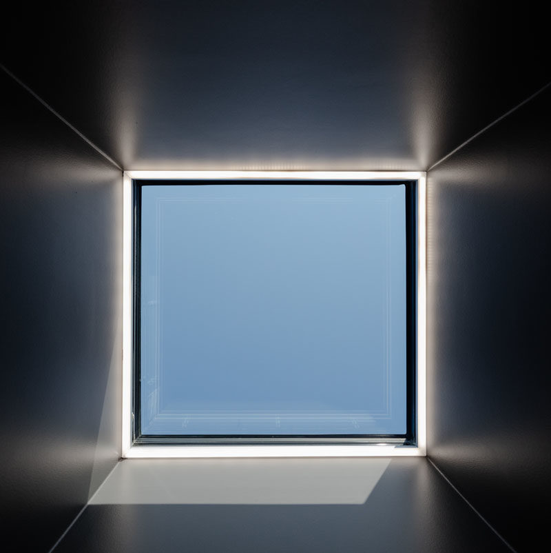 Window Ideas - A square skylight filters natural light through to a mostly dark space. #Skylight #ModernWindow #WindowIdeas #SkylightIdeas