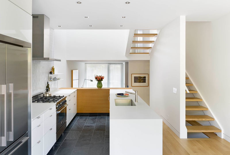 Kitchen Ideas - High ceilings make this mostly white kitchen and dining room feel open and bright. #WhiteKitchen #KitchenDesign #KitchenIdeas