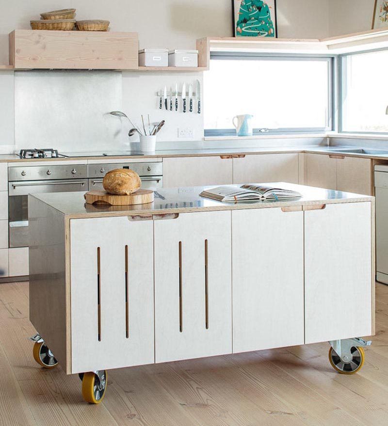 Kitchen islands on wheels don't just have to have an open design, where it's just a frame and a countertop. You can have a custom-designed portable kitchen island that includes cabinets that match the rest of your kitchen, or you can have a mix of cabinets, open shelving, and drawers. #PortableKitchenIsland #MovableKitchenIsland #KitchenIslandOnWheels #KitchenDesign