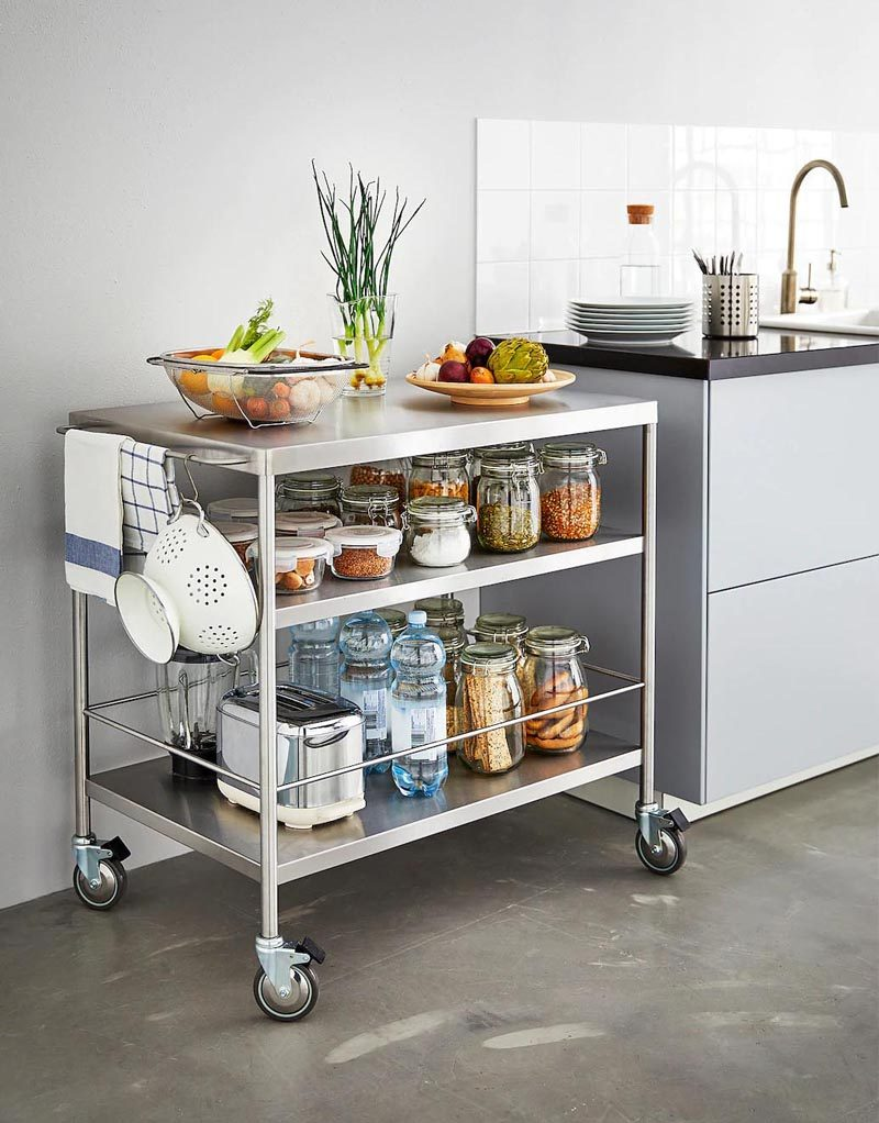 This portable kitchen island draws inspiration from the design of chef's kitchens, where stainless steel is the material choice. #PortableKitchenIsland #MovableKitchenIsland #KitchenIslandOnWheels #KitchenDesign