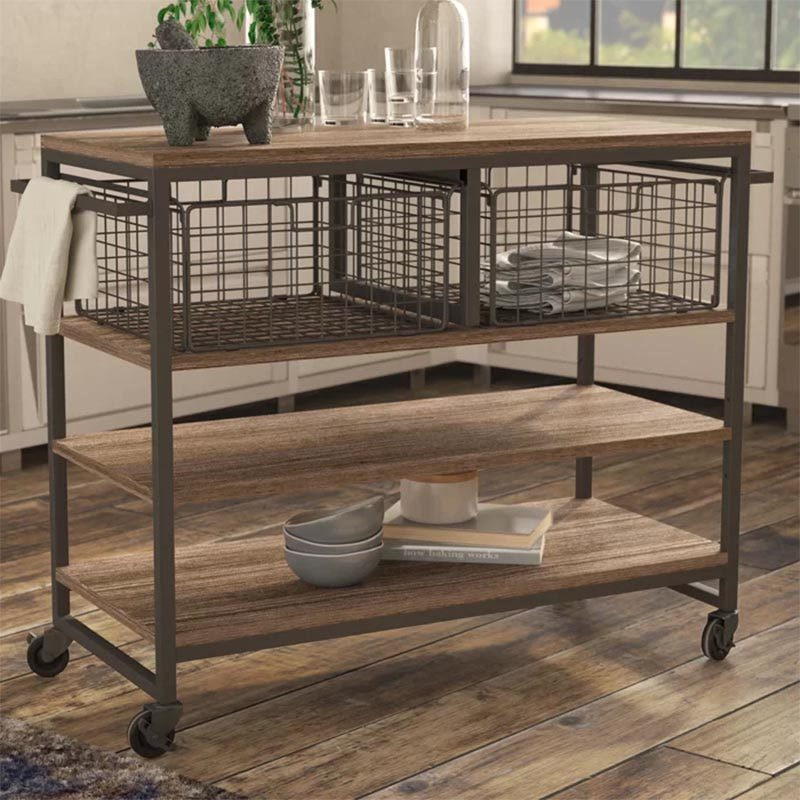 Industrial inspired kitchens often have design elements like exposed pipes and metal accents, however you can also add a kitchen island on wheels that has exposed wire baskets, a black metal frame, and a wood countertop. #PortableKitchenIsland #MovableKitchenIsland #KitchenIslandOnWheels #KitchenDesign