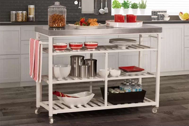 If you have a small kitchen, counter space and storage space is always lacking. One way of creating more counter space is by adding a kitchen cart on wheels, and as a bonus, they often have storage too. Portable kitchen islands don't have to be big, they can be narrow like these examples, that can also double as a bar cart or coffee station in a small apartment. #PortableKitchenIsland #MovableKitchenIsland #KitchenIslandOnWheels #KitchenDesign