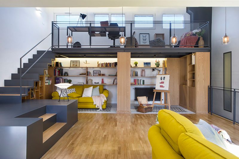 Design firm Egue y Seta, has recently completed an attic renovation that includes a living room and mezzanine with a home office. #AtticRenovation #InteriorDesign #ModernInterior