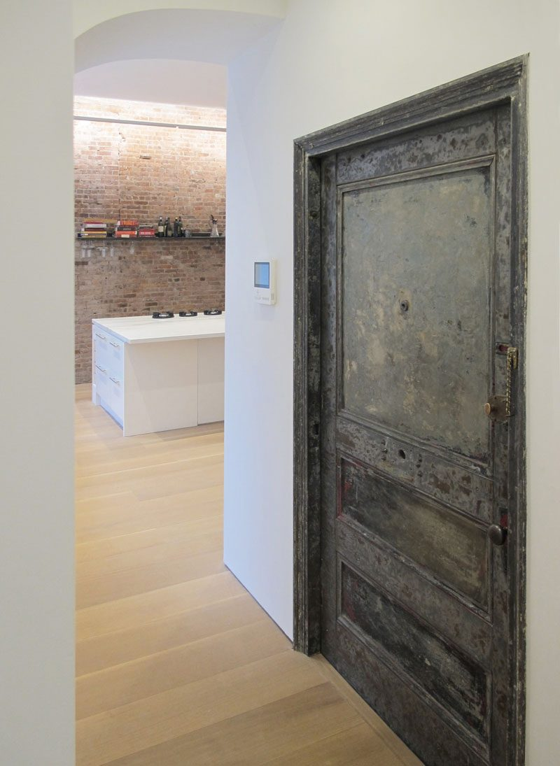An old existing metal door to the stairs was cleaned and re-used, showing a glimpse of the past. #MetalDoor #DoorIdeas