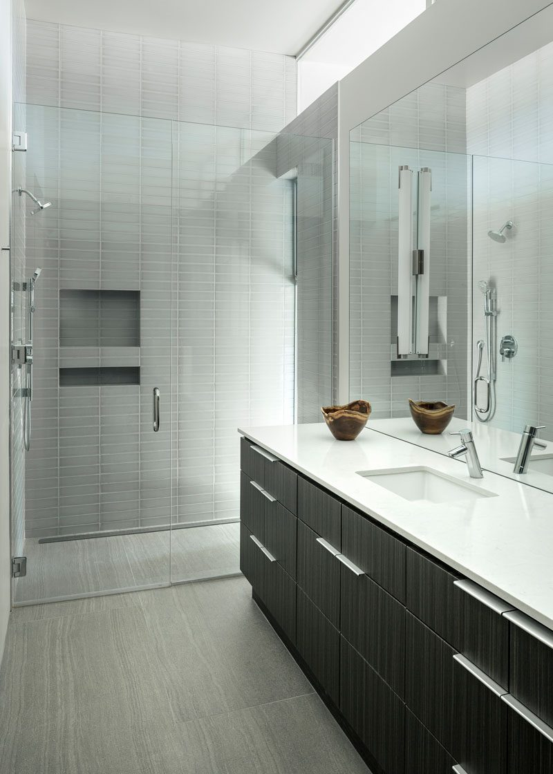 This modern bathroom has two shower niches to allow people at different heights to easily access them. #ShowerNicheIdeas #ModernShowerNiches #ShowerNiche #MultipleShowerNiches