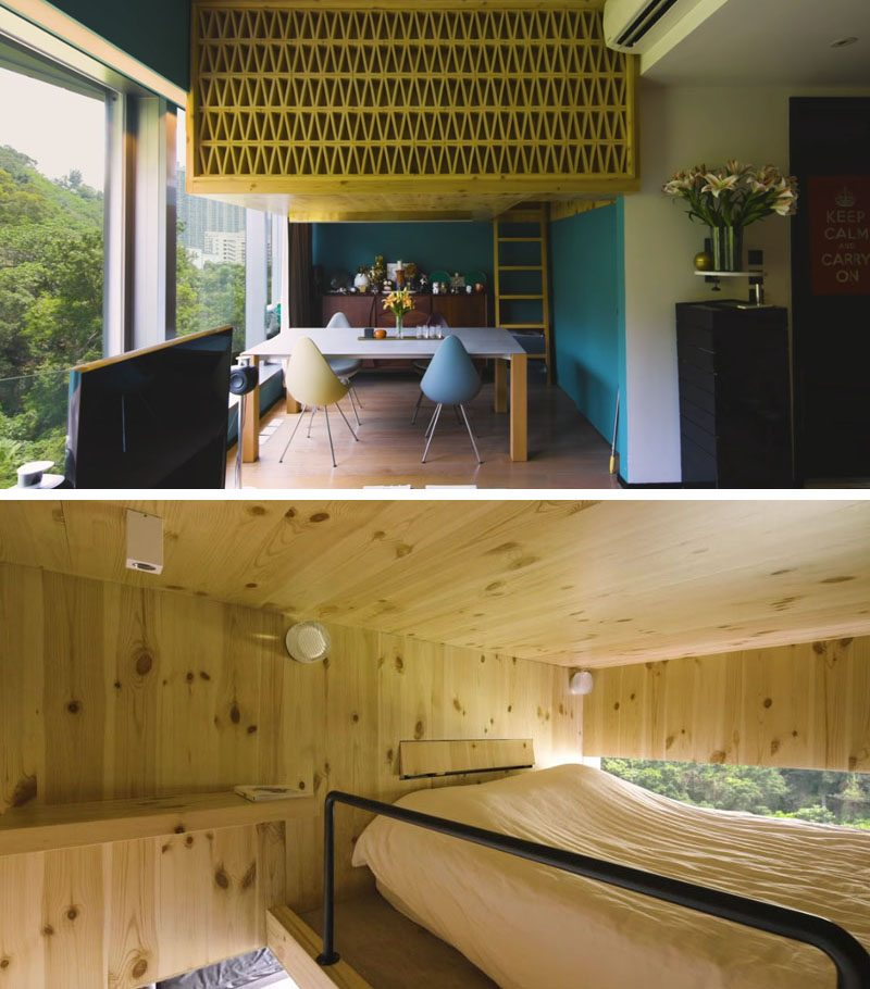 A box-loft sleeping area above the dining room in this small apartment, is clad in natural pine and seems to float like a tree house, with a window that provides views of the forest outside. #LoftedBedroom #BedroomLoft #SmallApartment #InteriorDesign