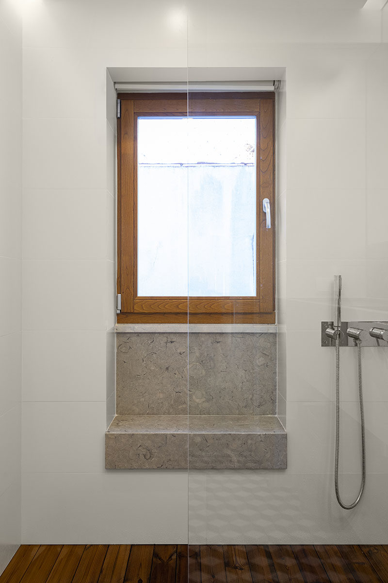Bathroom Ideas - The shower in this modern bathroom has a built-in window seat (or bench), that makes use of a small alcove. #BathroomIdeas #ShowerSeat #ShowerBench #WindowSeat #WindowBench #ModernBathroom