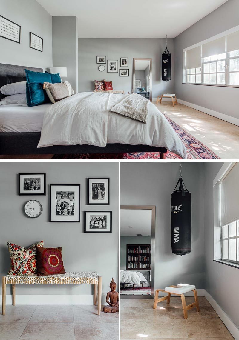 This contemporary guest room has grey walls, a punching bag that hangs from the ceiling, and a tiled floor. #GuestRoom #GuestBedroom
