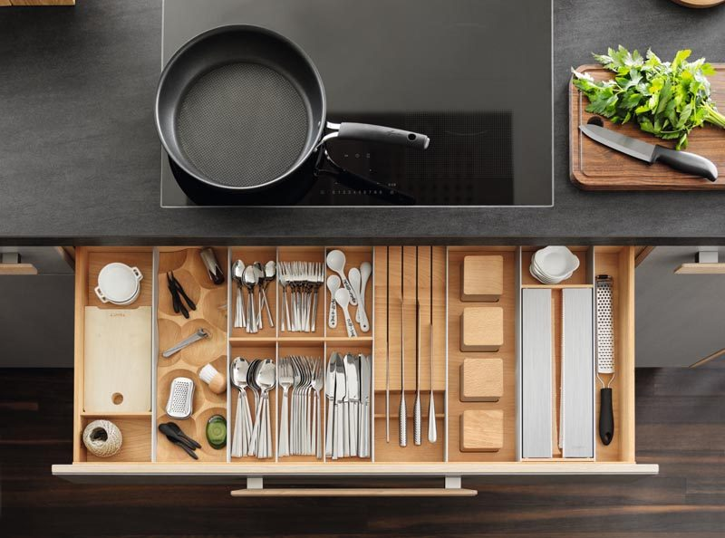 Kitchen Organization Ideas - This modern and modular drawer design combines removable trays, inserts, dividers, knife blocks, spice jars, and foil rolls that can be configured individually. A special solid-wood chopping board can also be integrated into the  drawer fittings. #KitchenOrganization #KitchenDrawerDesign #KitchenDesign