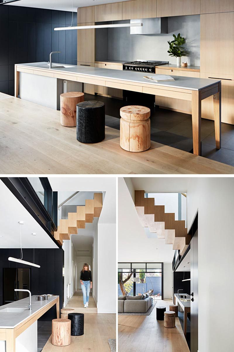 As this kitchen island is slightly stepped down, the designers decided to furnish the island with smaller wood stools. By using short stools, they can be moved easily to other areas of the house where they can double as side tables or extra seating. #KitchenIslandIdeas #KitchenIslandDesign #KitchenIslandStools #KitchenIslandSeating