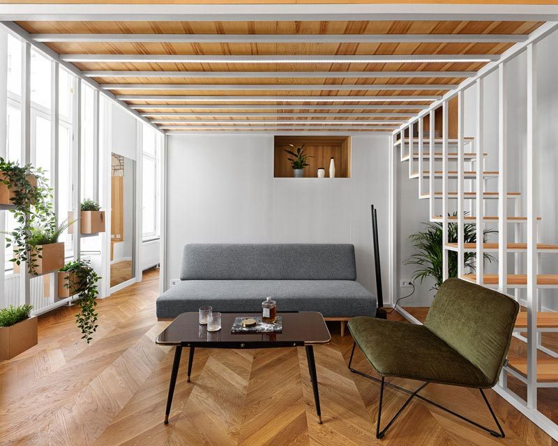 Architres Studio has designed the interior of a modern apartment in Budapest, Hungary, that has high ceilings and wood floors throughout. #ApartmentDesign #ApartmentInterior #ModernApartment