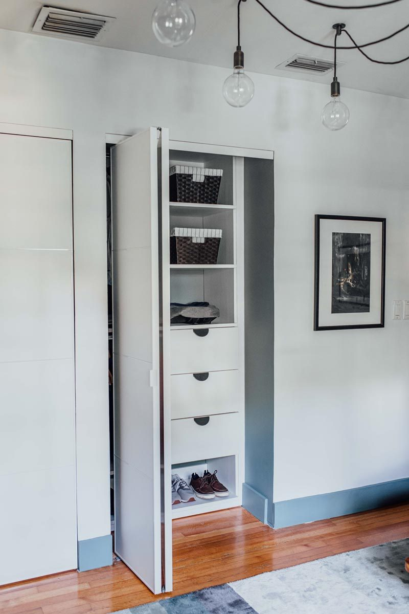 Storage Ideas - Custom shelving and drawers have been added to this modern closet for organized storage. #Closet #StorageIdeas