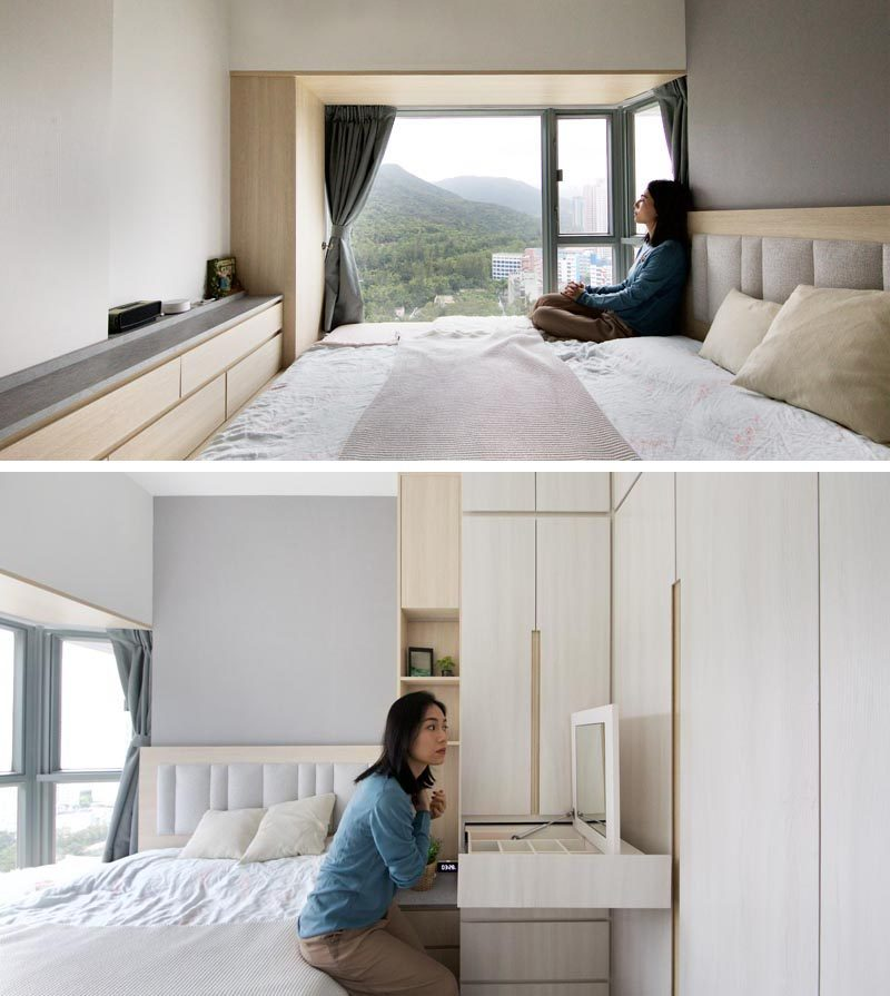 In the master bedroom of this small apartment, there's wood that lines an alcove by the window, while a cabinet runs the length of the room, and a closet as a pull-out make-up vanity. #BedroomDesign #SmallBedroom #Closet