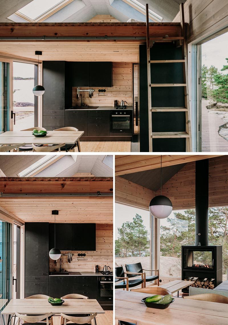 Inside this modern holiday cabin, there's a matte black kitchen and living room that also has a lofted sleeping area. The cabins allow for 10 adults to sleep comfortably, if needed. #Cabin #ModernCabin #BlackKitchen #Loft