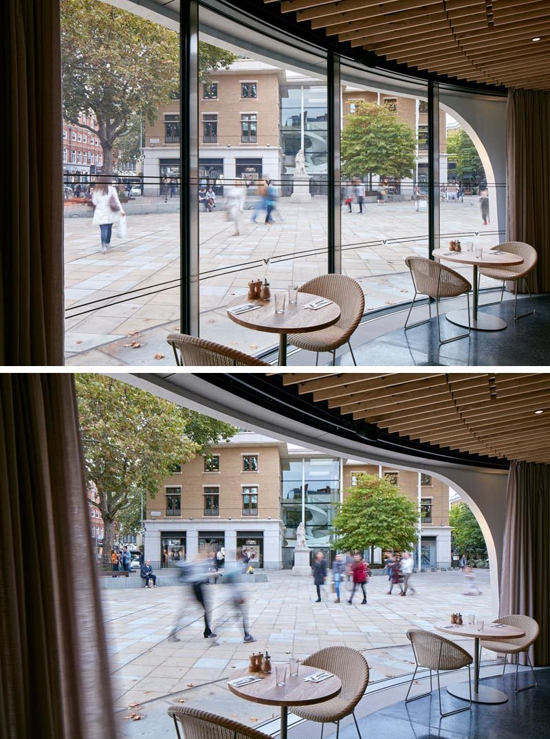 Sweeping curves of the large plate glass windows can be opened to connect the ground floor interior of the restaurant with the square. #Windows #RestaurantWindows #CurvedWindows