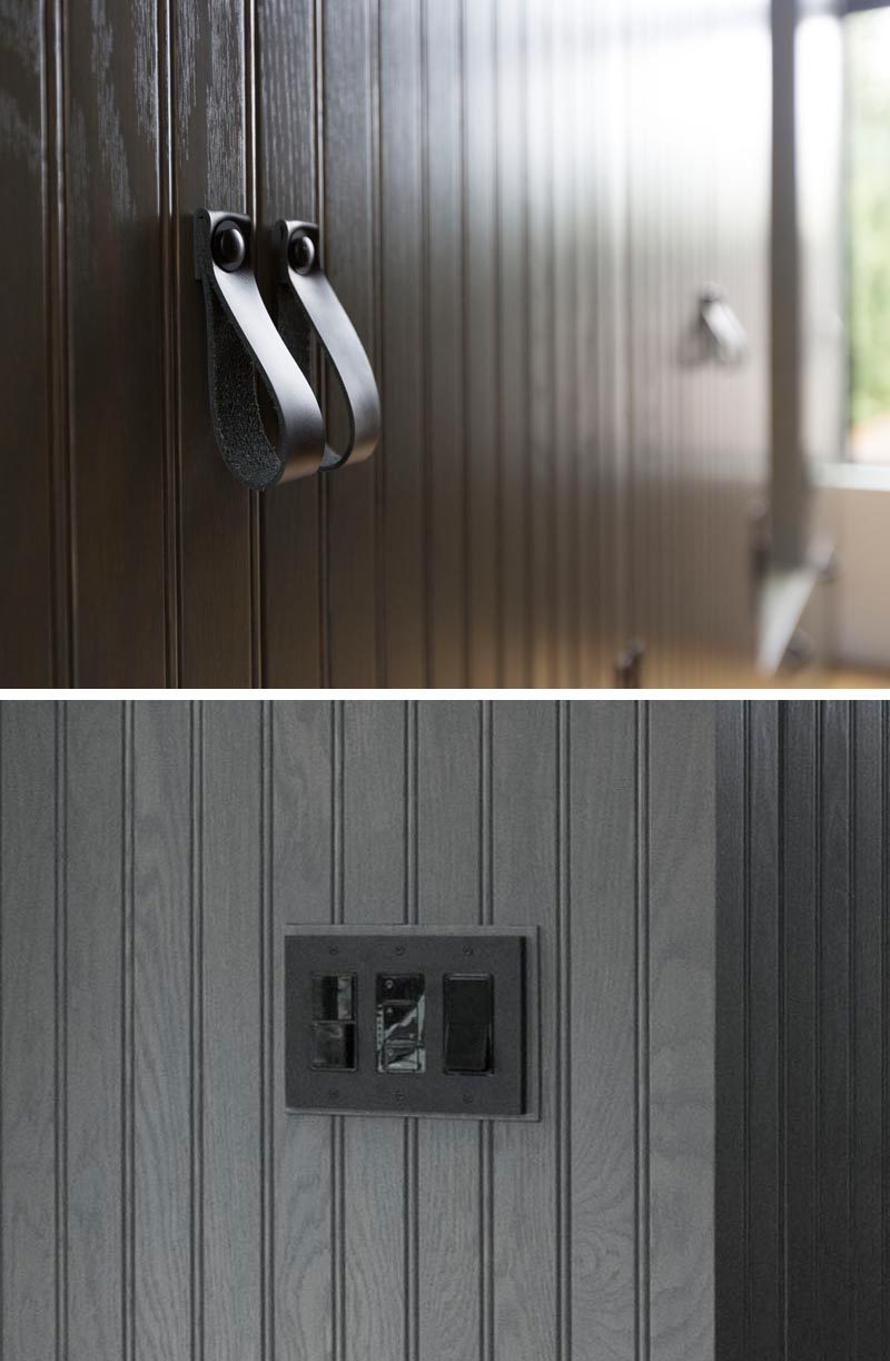 Black hardware such as leather pulls and light switches have been used so that they somewhat blend in with the dark grey finish of the closets. #BlackLeatherPulls #DarkGreyCabinets