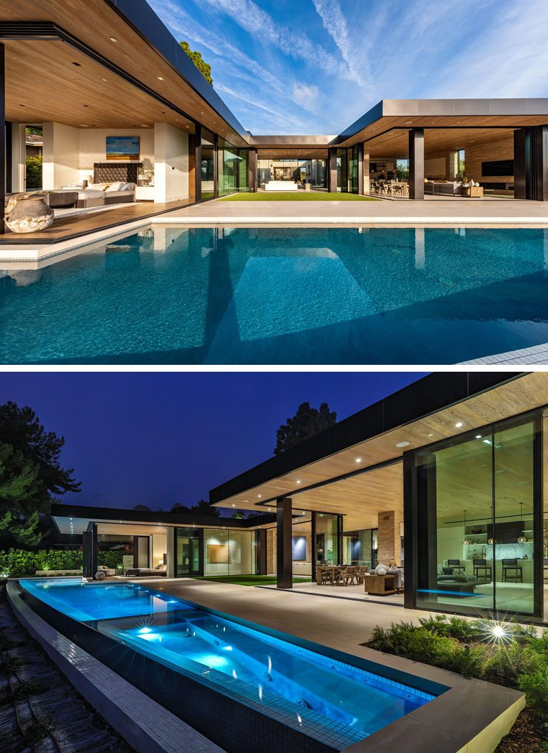 The walls of the social areas of this modern house also open up to the patio and swimming pool, which at night has lights to highlight it. #ModernHouse #SwimmingPool