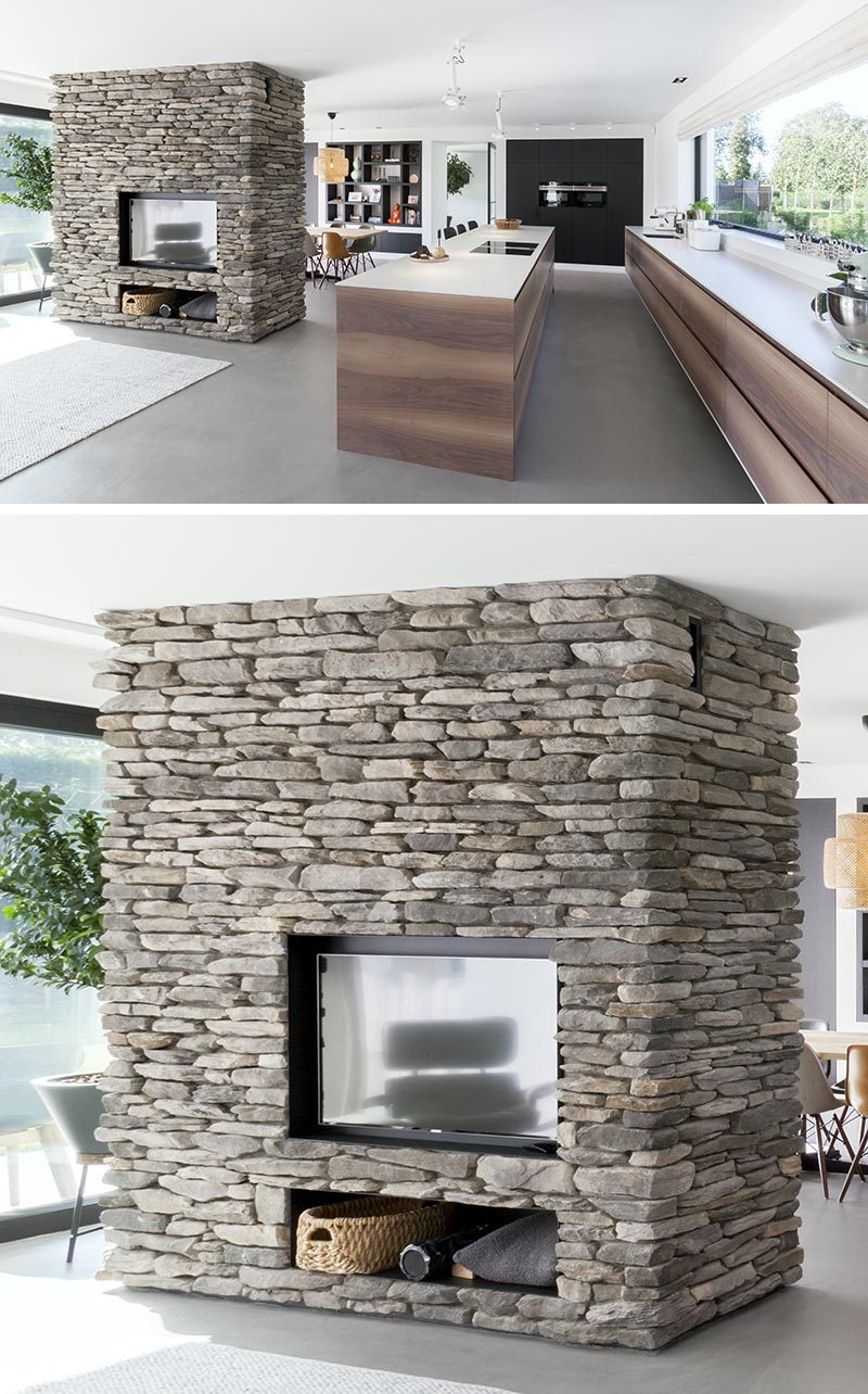This Stone Partition Provides A Home For A Fireplace And Television
