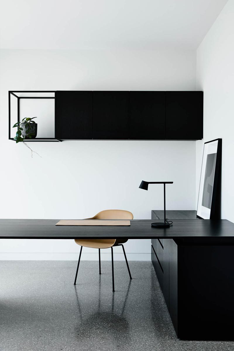 In this study, minimalist black furnishings create a distraction-free place to work. #ModernStudy #Minimalism #InteriorDesign #HomeOffice