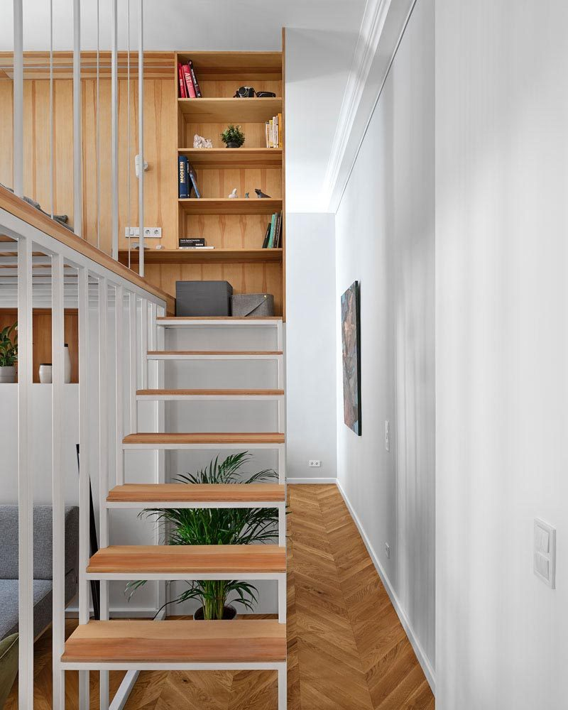This modern apartment has stairs that lead up to a mezzanine loft bedroom. #Stairs #ModernStairs