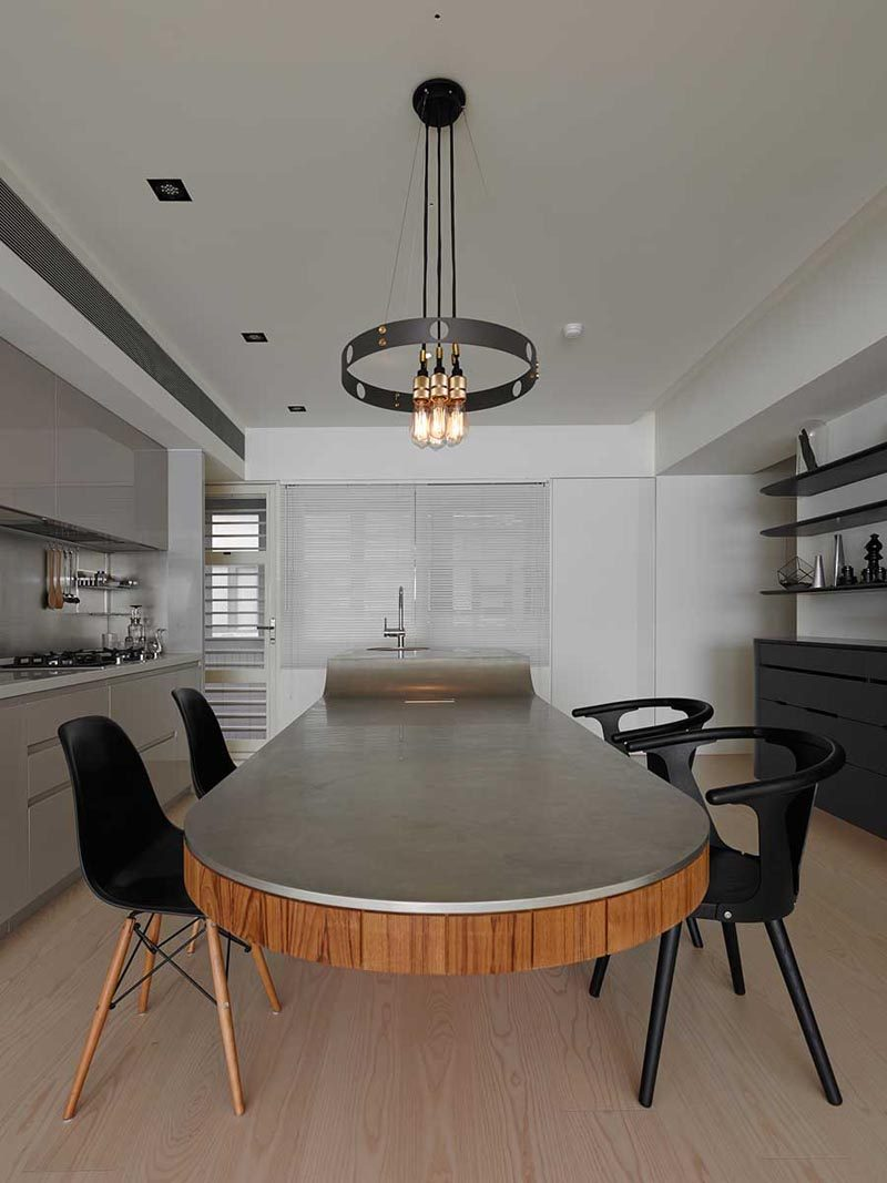 Kitchen Island Idea A Multi Height Island With Cantilevered Table And Seating